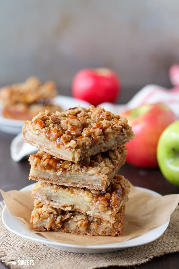 Caramel Apple Crumb Bars - A brown sugar oat crumble serves as both the crust and topping for these Caramel Apple Crumb Bars. Filled with cinnamon spiced apples and topped with caramel sauce you'll love this easy fall dessert.