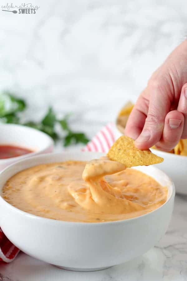 Real Cheese Queso Dip - A creamy and supremely cheesy Queso Dip made with real cheddar cheese. Serve with tortilla chips for dipping OR make homemade Queso Mac and Cheese!