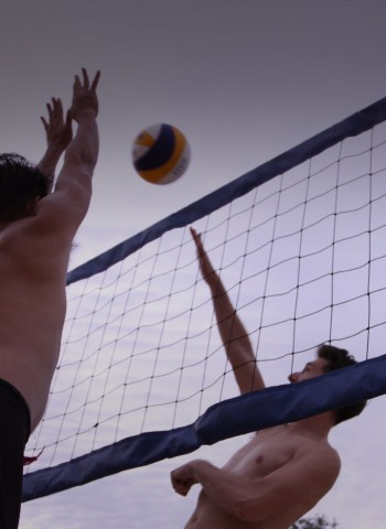 two men playing volleyball