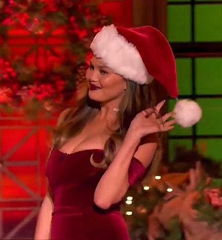 Chrissy Teigen in Nicholas Bordeaux Velvet Off-The-Shoulder Dress on Lip Sync Battle Christmas Show 2016