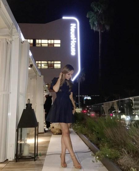 Nicole Lapin, Self-Portrait Hudson Lace-Yoke Ruffle Mini Dress and Stuart Weitzman Nudist Sandals (Instagram April 27, 2017)