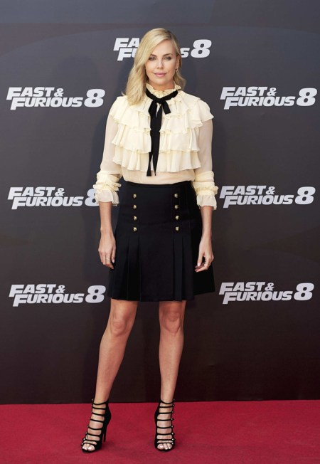 Charlize Theron wore a Gucci Ruffled Silk Georgette Shirt with a bow and Gucci Military Skirt to the 'Fast & Furious 8' Photocall on April 6, 2017 in Madrid, Spain.