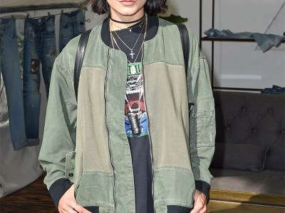 Vanessa Hudgens attends the Hudson Jeans FYF Fest Style Lounge at Exposition Park on July 23, 2017 in Los Angeles, CA. She is wearing the brand's Hudson Jeans Gene Bomber Jacket, which features patchwork and subtly distressed edges. Her black flat cap is the Urban Outfitters Greek Fisherman Hat and her sunnies are Quay Purple Honey Geo Sunglasses in Gold.