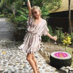 Julianne Hough thanks her followers for their well wishes for her birthday and marriage in a celebratory Instagram shot posted on July 21, 2017. Posing on a private island, where she is currently honeymooning, Julianne wears a Zimmermann Jasper Stripe Smock Dress and a pair of Chloe Carlina Round Mirrored Sunglasses.