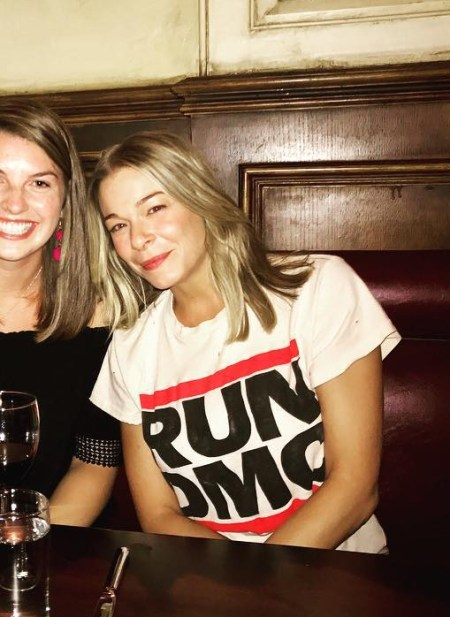 LeAnn Rimes poses with fans at Philadelphia's Parc restaurant (July 2017), wearing a MadeWorn Run DMC Distressed Printed Cotton-jersey T-shirt in off-white.
