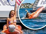 Abbie Chatfield slips into a bikini and rides an inflatable turtle on Sydney Harbour