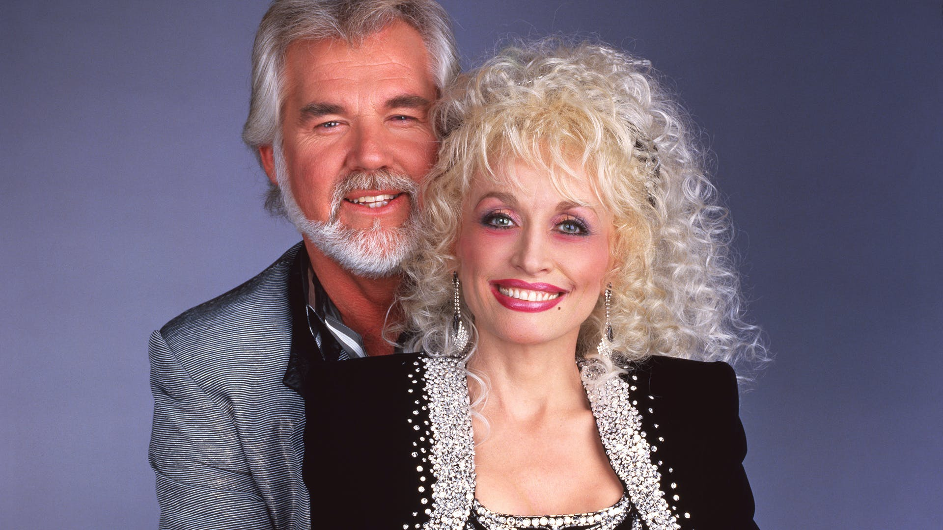 """dolly-parton-dishes-on-her-very-private-marriage-with-longtime-husband-carl-dean-jokes-about-theories-hes-made-up"""
