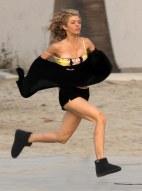 AnnaLynne_McCord_has_a_nip_slip_while_running_on_the_set_of_90210_in_Malibu_02