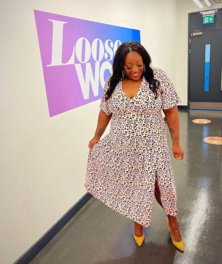 Judi Love in a style dress