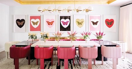 A Dining table at Kylie's house all in pink with fancy items.