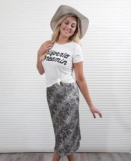 Gina Kirschenheiter sporting a 'California Dreamin' white shirt with a hat.