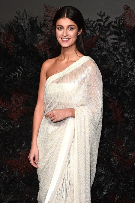 Anya Chalotra in a traditional white Indian Saree.