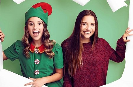 Annie LeBlanc and Maddie Ziegler ripping the poster for 'Holiday Spectacular'.