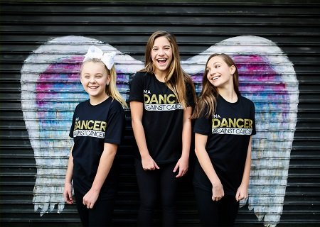 "JoJo Siwa (L), Mackenzie Ziegler (C) and Maddie Ziegler (R) promoting I'm A Dancer Against Cancer's new ""Angels & Warriors"" tee."