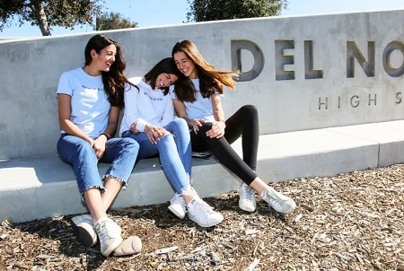 The Bulkin Sisters and Ellie Zeiler in front of their high school.