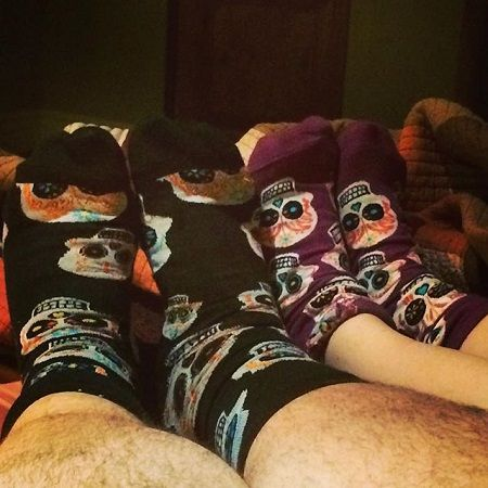 Jorge's and Rebecca's legs only shown wearing matching socks.