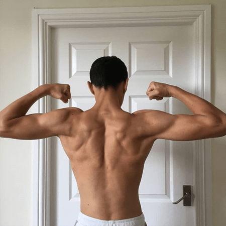 Daniel Frogson showing off his back and his trapezoid muscle.