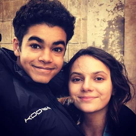 Amir Wilson with his His Dark Materials co-star Dafne Keen.