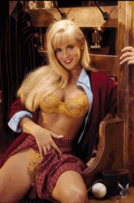 Jenny McCarthy's playboy Miss October 1993 center fold with school girl uniform.