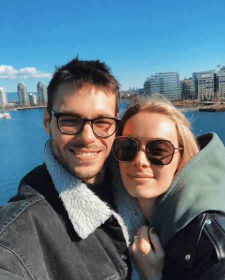 Rachel Skarsten and her boyfriend Alexandre Robicquet taking a picture near the ocean.