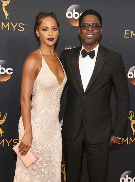 Megalyn Echikunwoke and Chris Rock together at the Emmy Awards.