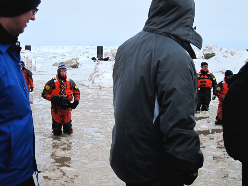 EMT worker with camera at the polar plunge