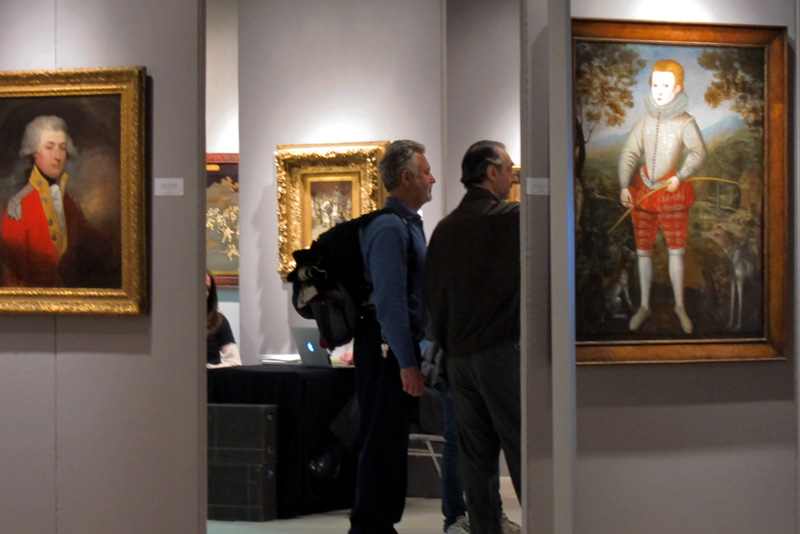 Patrons in a booth at the 2014 Chicago Art Antique and Jewelry Show