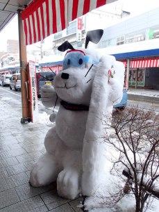 Snowboarding dog