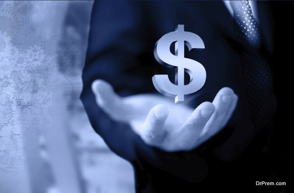 Businessman hand holding financial symbols isolated on blue background