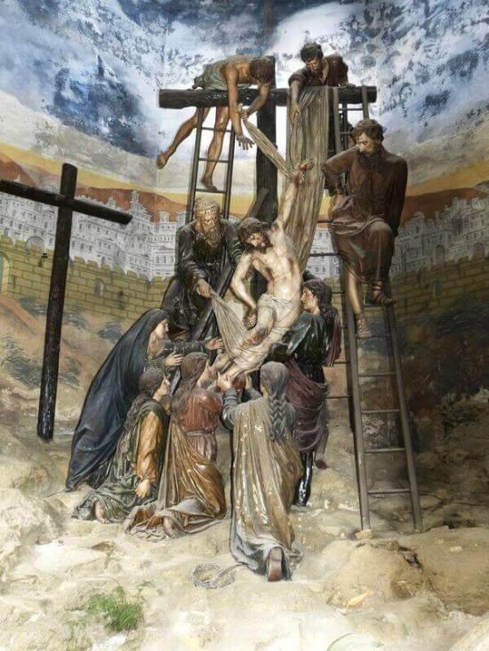 Es el Monte Calvario y estan bajando a Jesucristo de la cruz ahi estan algunas personas ayudando y tambien Maria la madre de El