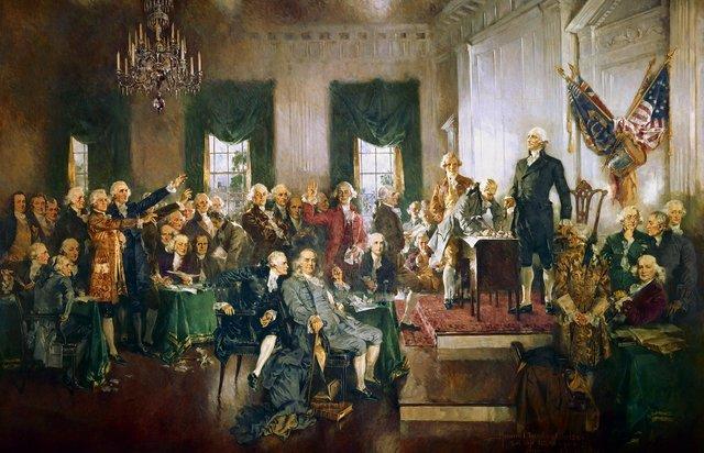 Es un cuadro de una asamblea con el primer presidente de los Estados Unidos George Washington.