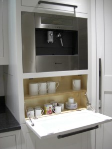 Multi-function cupboard with coffee machine and cup storage by Celtica Kitchens, designer Cameron Pyke
