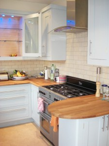 Duck Egg Blue Shaker Style Kitchen, Wooden Worktops, glass fronted wall cabinets with blue LED lighting, Copyright Celtica Kitchens 2014