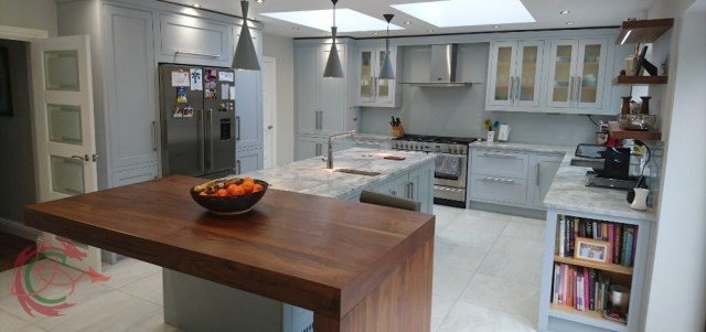 Affordable bespoke kitchen in Hertfordshire with walnut breakfast bar by Celtica KItchens