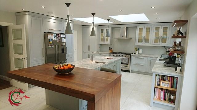 framed shaker kitchen with minimalist slab breakfast bar in walnut