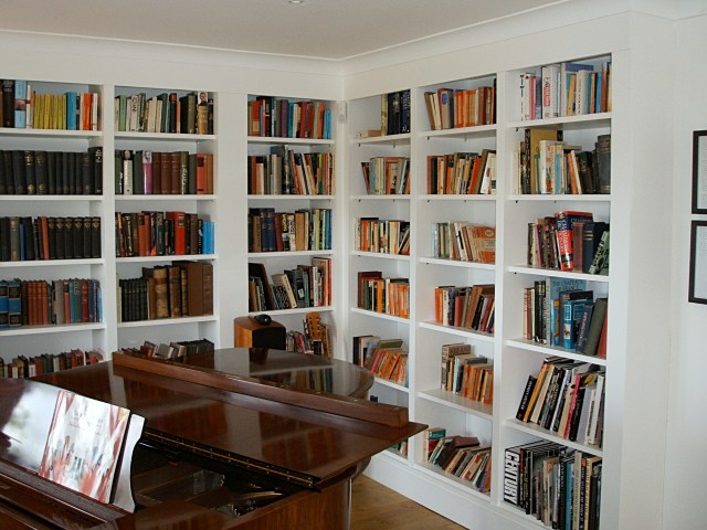 bespoke bookcases, bookshelves fitted in family music room, library