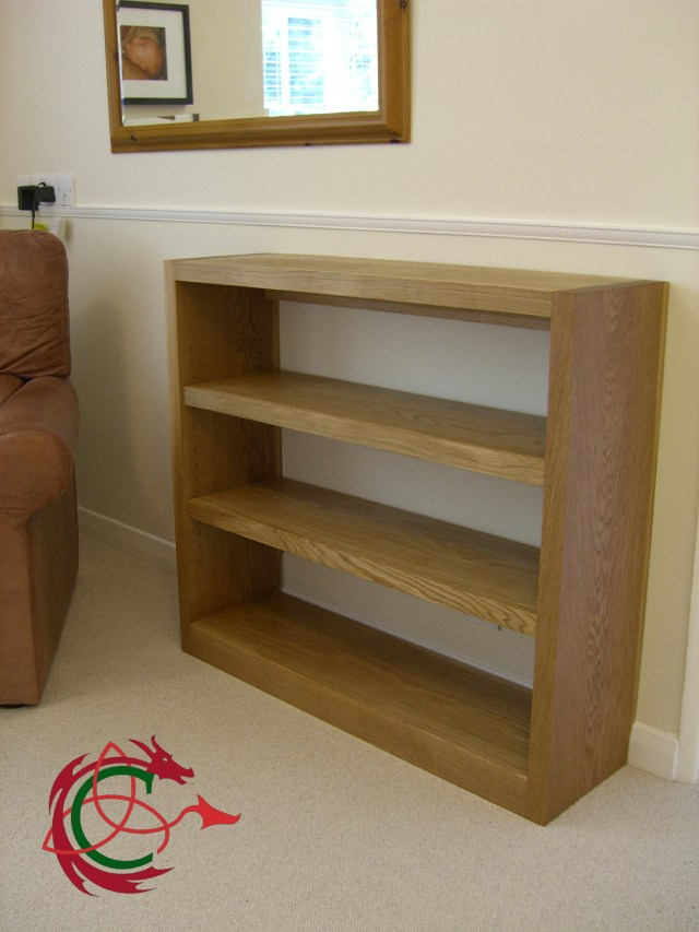 simple solid oak bookcase, bookshelves in living room