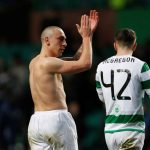 Celtic's Scott Brown and Callum McGregor applaud the fans