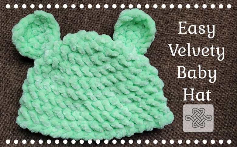 green crocheted baby hat with ears