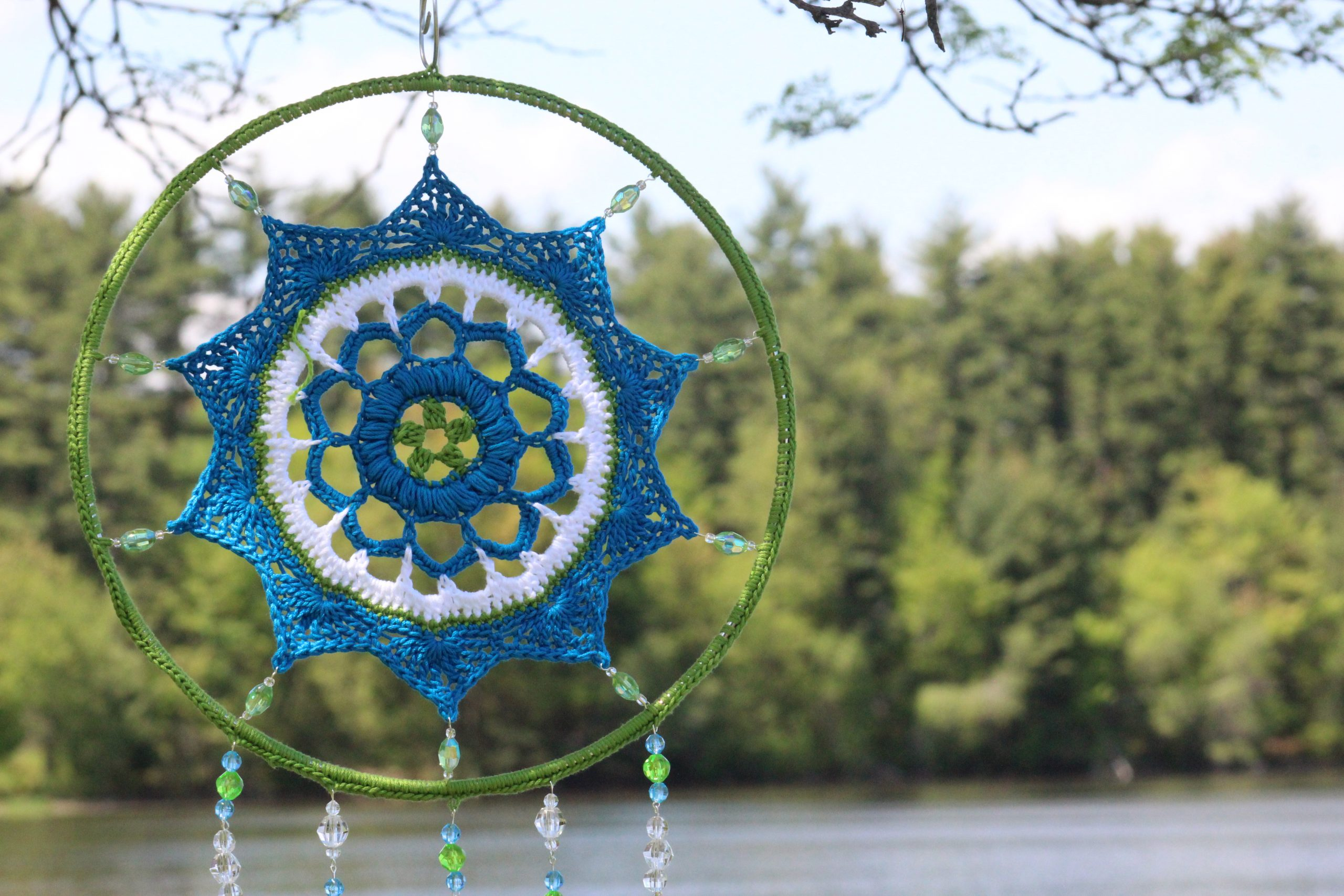 crochet mandala stretched across a ring