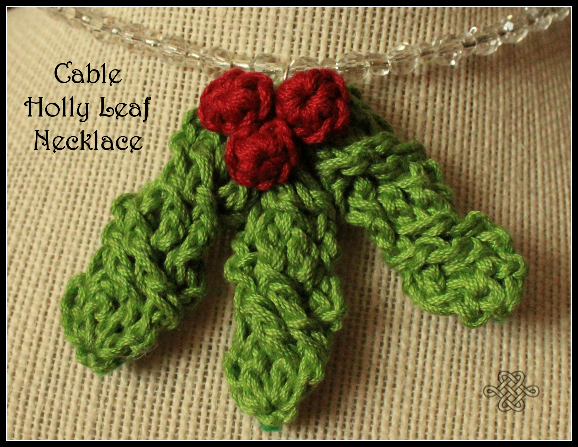 crocheted green holly leaves with red berries on a necklace