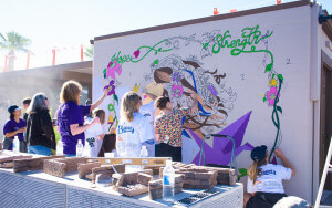 Painting the mural of inspiration Photo credit: Brianna Nessler, Small Giants
