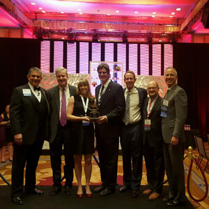 NAIOP Arizona representatives (second, l to r) Tim Lawless, Tammy Carr, Tony Lydon, Andrew Cheney and Jonathan Tratt with the award for Large Chapter of the Year at the national conference in Washington, D.C.
