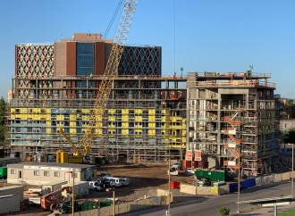 """Mortenson Celebrates Construction Progress With First """"Topping Out"""" Ceremony in Novus Innovation Corridor"""