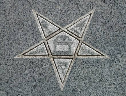Eastern star with symbols of Biblical figures Adah, Ruth, Esther, Martha and Electa.