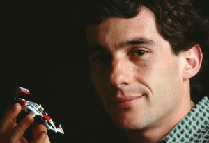 Ayrton_Senna_with_toy_car_cropped_no_wm