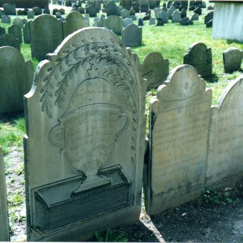 Urn shaded by a weeping branch on marble stone, Granary Burial Ground, Boston