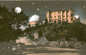 Vintage postcard of the moon rising over the Lick Observatory.