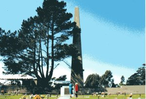 An obelisk marks the Pioneer Mound at Cypress Lawn