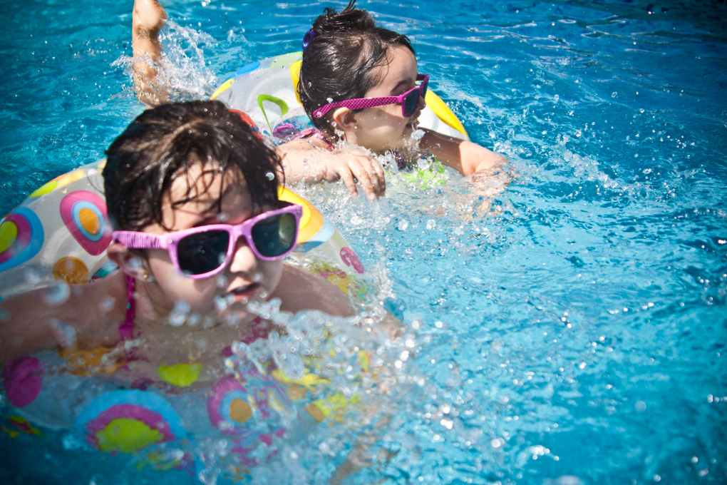 Dry drowning prevention for young boy in pool half submerged.